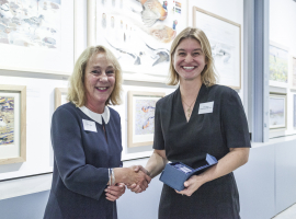Image of Becki Lawson receiving the award from Sara Oldfield Credit Nick Caro